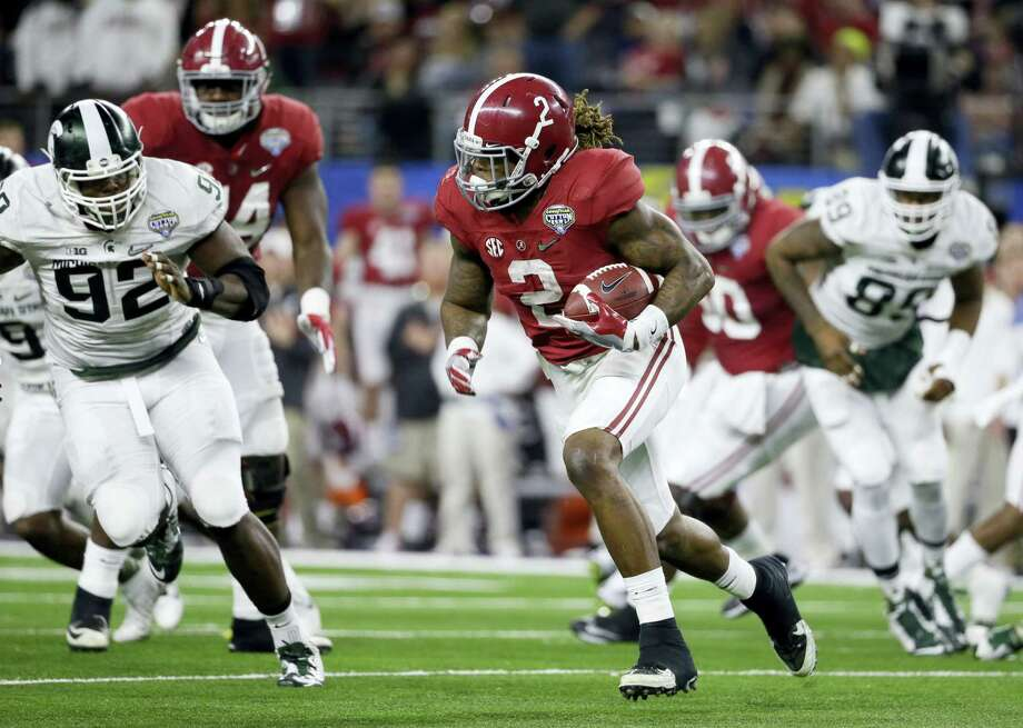 Alabama running back Derrick Henry runs the ball against Michigan State during the first half of the Cotton Bowl College Football Playoff semifinal game on Thursday in Arlington, Texas. Photo: Tony Gutierrez — The Associated Press   / AP