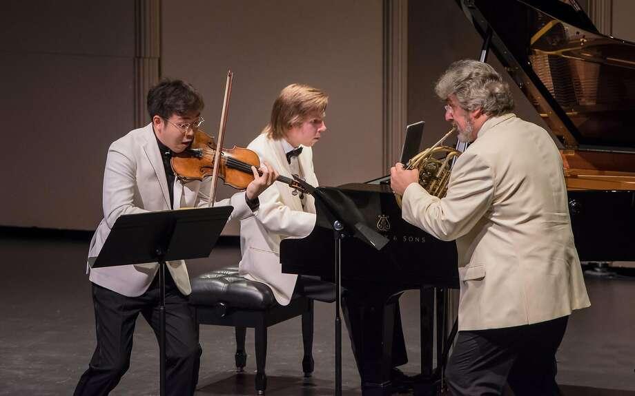 Paul Huang, violin; Juho Pohjonen, piano; and Radovan Vlatkovic, French horn perform Brahms' Horn Trio. Photo: Carlin Ma