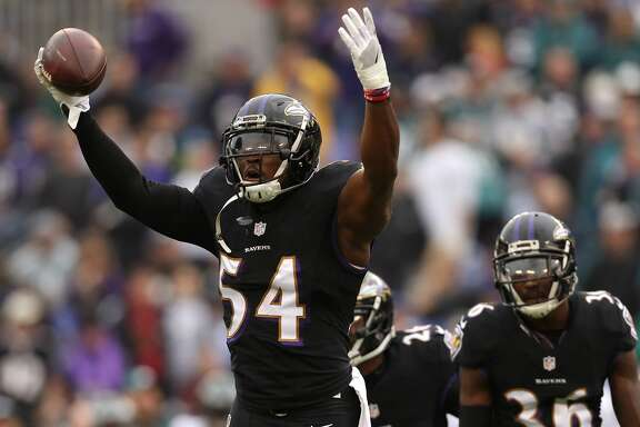BALTIMORE, MD - DECEMBER 18: Inside linebacker Zach Orr #54 of the Baltimore Ravens reacts after making an interception in the first quarter against the Philadelphia Eagles at M&T Bank Stadium on December 18, 2016 in Baltimore, Maryland. (Photo by Patrick Smith/Getty Images)