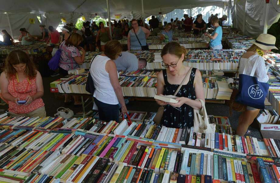 Fairfield resident Laura Stern shops for books during the The Pequot Library's 57th Annual Summer Book Sale Friday, July 21, 2017, in Fairfield, Conn. The book sale continues through Tuesday and offers over 140,000 books as well as CDs and records and proceeds from the sale directly fund Pequot Library's programs, library services, and events. Photo: Erik Trautmann / Hearst Connecticut Media / Norwalk Hour
