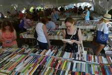 Fairfield resident Laura Stern shops for books during the The Pequot Library's 57th Annual Summer Book Sale Friday, July 21, 2017, in Fairfield, Conn. The book sale continues through Tuesday and offers over 140,000 books as well as CDs and records and proceeds from the sale directly fund Pequot Library's programs, library services, and events.