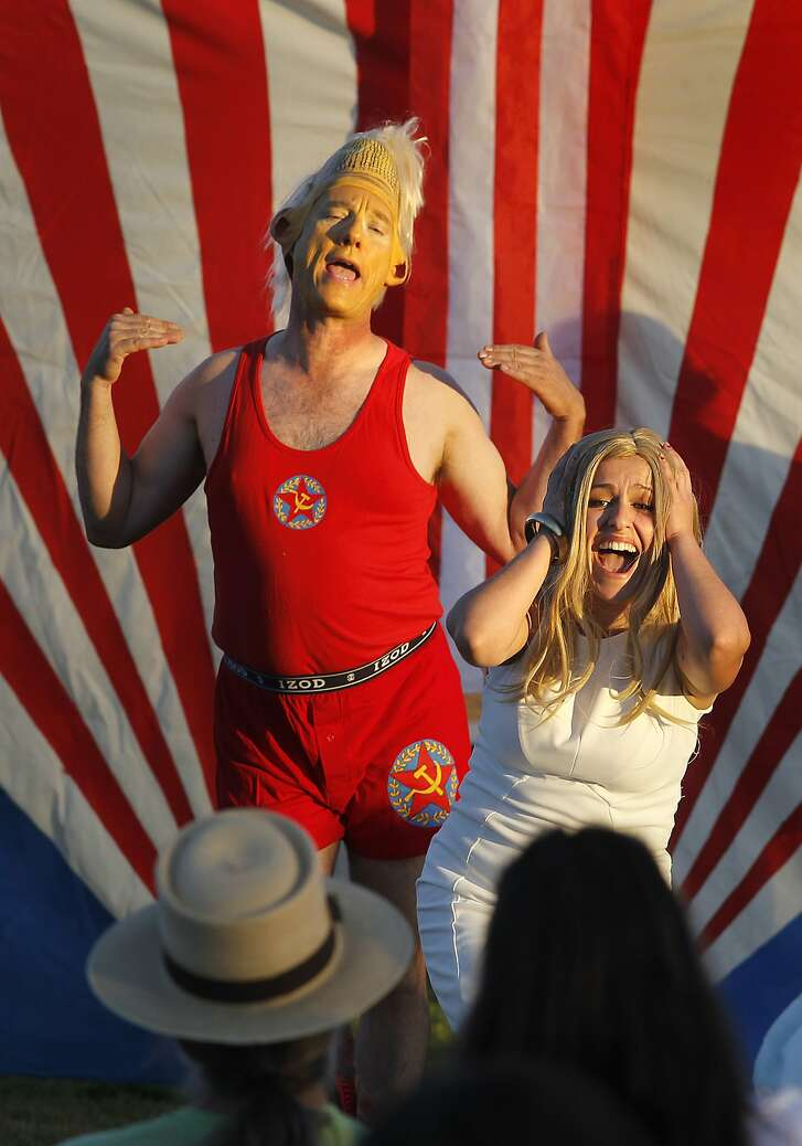 """President Corn (left) and his daughter react to the president's new suit. The Imaginists' ninth annual """"Art is Medicine Show"""" is a free, bilingual bicycle-powered play that tours public parks in Santa Rosa, Calif. Friday July 21, 2017."""