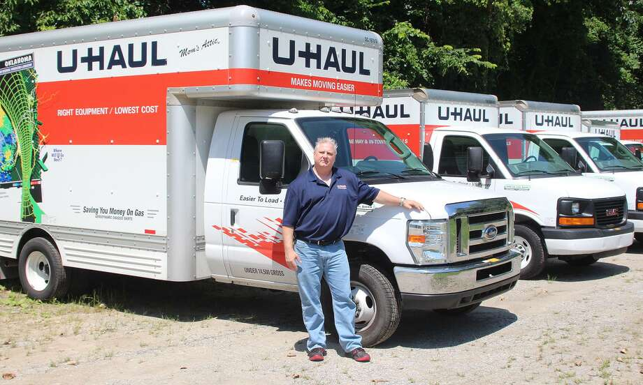 Paul Burrachio, owner of the U-Haul on Anderson Avenue in New Milford, Conn., stands near his fleet of moving vehicles on Wednesday, July 19, 2017. Photo: Chris Bosak / Hearst Connecticut Media / The News-Times
