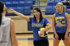 Evadale head coach Debbie Hollyfield recorded her 300th career victory last week when the Lady Rebels defeated Hull-Daisetta in four sets. Evadale volleyball coach Debbie Hollyfield gives her players instructions on positioning during an after-school practice Monday. The Rebels are looking strong as they head into districts, and have their eyes set on advancing to the state play-offs. Photo taken Monday, October 6, 2014 Kim Brent/@kimbpix   Manditory Credit, No Sales, Mags Out, TV Out, Web: AP Members only