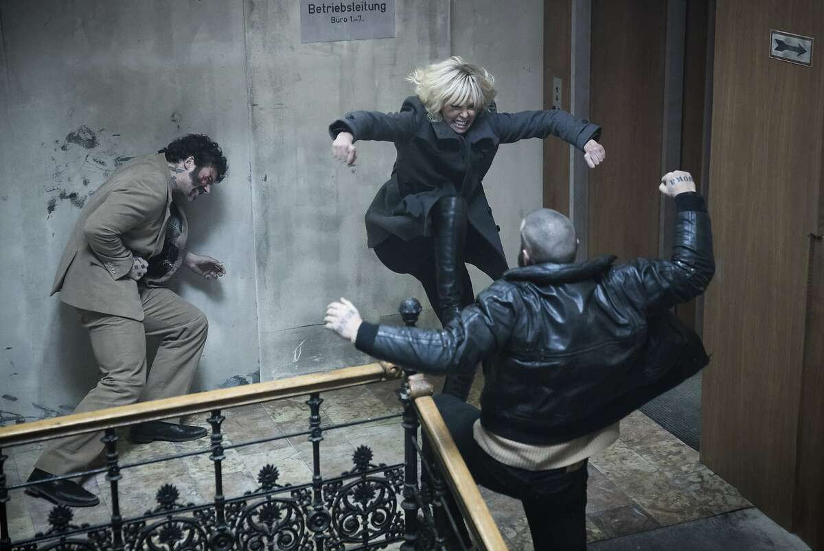 """This image released by Focus Features shows Charlize Theron, center, in """"Atomic Blonde."""""""