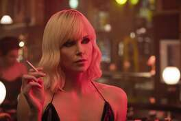 """This image released by Focus Features shows Charlize Theron in """"Atomic Blonde."""" (Jonathan Prime/Focus Features via AP)"""