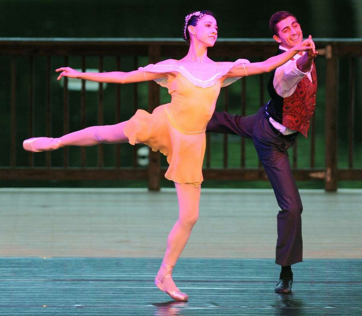 """Claire Mazza, left, and Morgan Stinnet dance during the dance routine """"Embraceable You"""" at Connecticut Ballet's Summer Dance Caravan Tour performance, """"Fabulous Duets for a Summer Evening,"""" at Ives Concert Park in Danbury, Conn. on Friday, July 26, 2013."""
