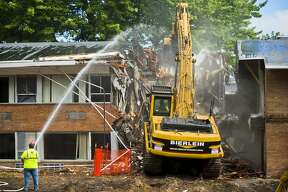 Demolition begins on MidMichigan Medical Center's Sugnet Building, also known as the original Midland Hospital, which will be replaced with a new Heart and Vascular Center, on Monday, July 24, 2017 in Midland.
