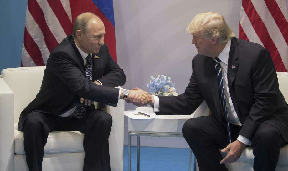 President Vladimir Putin of Russia and President Donald Trump greet each other at the G20 conference in Hamburg, Germany, July 7, 2017. President Trump has little choice, his aides acknowledge, but to sign legislation for toughened U.S. sanctions against Russia that he wanted to see defeated. Photo: STEPHEN CROWLEY /NYT / NYTNS