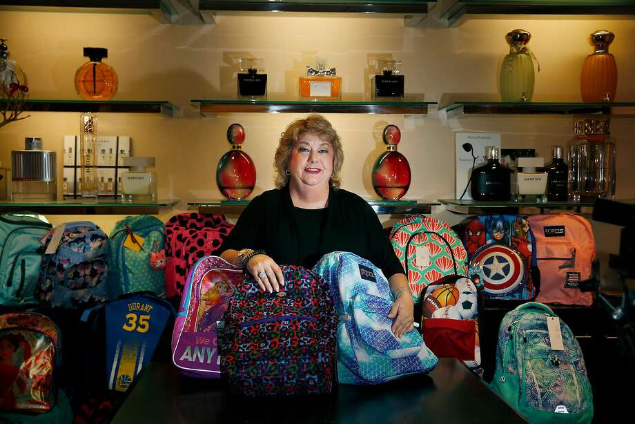Marsha Sanders,  cosmetics manager at Bloomingdale's, helps collect backpacks and school supplies for children at the nonprofit Hamilton Families in S.F. Photo: Lea Suzuki, The Chronicle