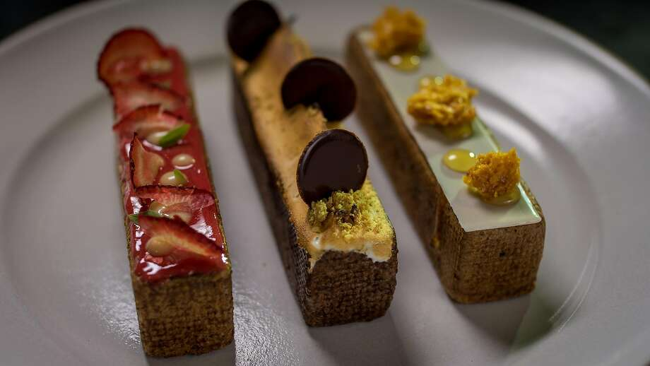 Dessert plate of three eclairs ($12). Photo: John Storey, Special To The Chronicle