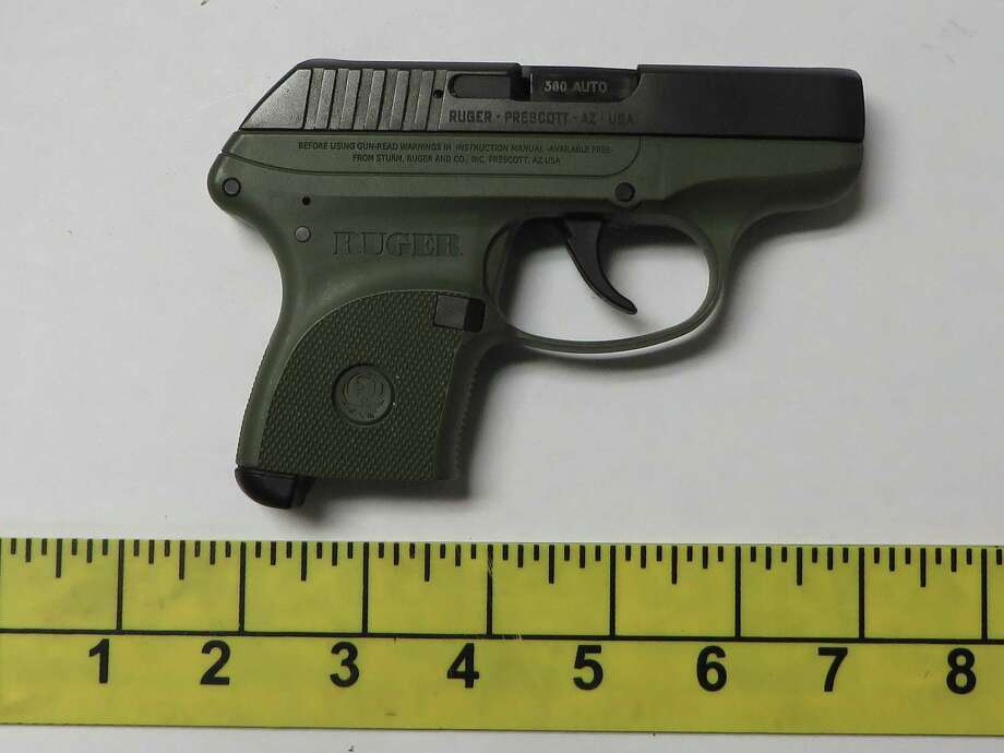 The loaded semiautomatic pistol that police found stashed under a recycling bin by a man who was going to the Stamford courthouse to see his probation officer. Photo: Stamford Police / Contributed