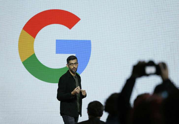 """Google CEO Sundar Pichai speaks during a product event, Tuesday, Oct. 4, 2016, in San Francisco. Second-quarter revenue for Google parent Alphabet Inc. met analysts' projections, but fell short of the most-optimistic estimates. The company's profit was also hammered by a record antitrust fine from the European Union. Google launched an aggressive challenge to Apple and Samsung, introducing its own new line of smartphones called Pixel, which are designed to showcase a digital helper the company calls """"Google Assistant."""" The new phones represent a big, new push by Google to sell its own consumer devices, instead of largely just supplying software for other manufacturers. (AP Photo/Eric Risberg)"""