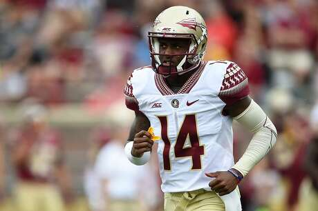 TALLAHASSEE, FL - APRIL 11:  De'Andre Johnson #14 of the Gold team runs to the sideline following a rushing touchdown against the Garnet team during Florida State's Garnet and Gold spring game at Doak Campbell Stadium on April 11, 2015 in Tallahassee, Florida.  (Photo by Stacy Revere/Getty Images)