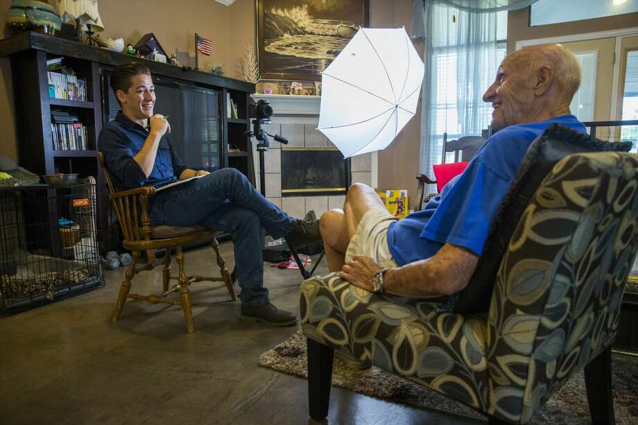 Andy Fancher, 18, interviews WWII U.S. Navy veteran Bob Gagnon, 92, on July 13, 2017, in Mansfield, Texas. Fancher has filmed countless hours of interviews with war veterans, including more than 30 WWII veterans. (Ashley Landis/Dallas Morning News/TNS) Photo: Ashley Landis/TNS
