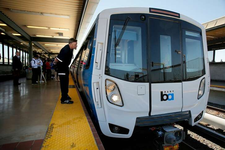 23 year train operator Kirk Paulsen peers inside the new train car as it pulls into the Hayward South station, as BART shows off one of their new trains to the media at the South Hayward station, Ca., as seen on Mon. July 23, 2017.