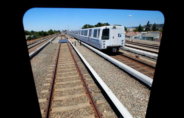 The view from a new train as a current model passes by while BART shows off one of their new train cars for to the media at the South Hayward station, Ca., as seen on Mon. July 23, 2017.