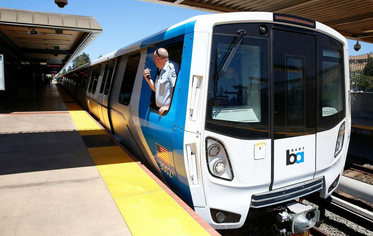 The train operator checks the platform as BART shows off one of their new trains to the media at the South Hayward station in July 2017. BART recently began running one of the trains through San Francisco.