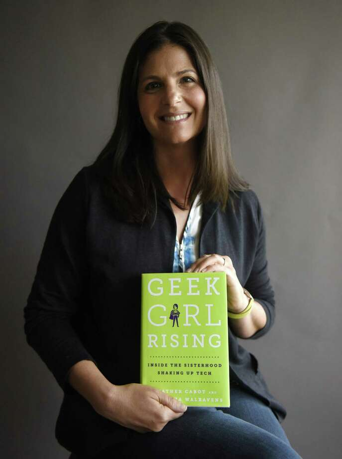 "Local author Heather Cabot poses with her book ""Geek Girl Rising"" at the Greenwich Time photo studio in Old Greenwich, Conn. Wednesday, July 12, 2017. ""Geek Girl Rising,"" written by Cabot and Samantha Walravens, explores the realm of women in technology and STEM fields and calls for women to join the digital revolution and get involved with STEM despite the obstacles. Photo: Tyler Sizemore / Hearst Connecticut Media / Greenwich Time"