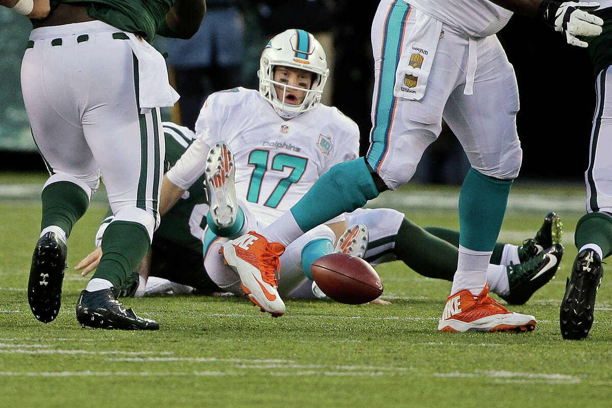 Dolphins quarterback Ryan Tannehill fumbles the ball after being sacked by the Jets' Sheldon Richardson on Sunday in East Rutherford, N.J.