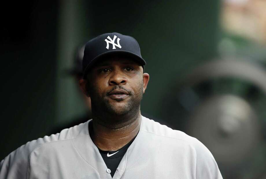 New York Yankees' CC Sabathia walks through the dugout during a baseball game  against the Texas Rangers Thursday, July 30, 2015, in Arlington, Texas. (AP Photo/Tony Gutierrez) Photo: AP / AP