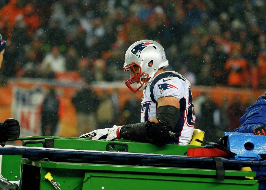 New England Patriots tight end Rob Gronkowski is carted off the field after being injured against the Broncos Sunday night in Denver. Photo: The Associated Press   / FR42408 AP