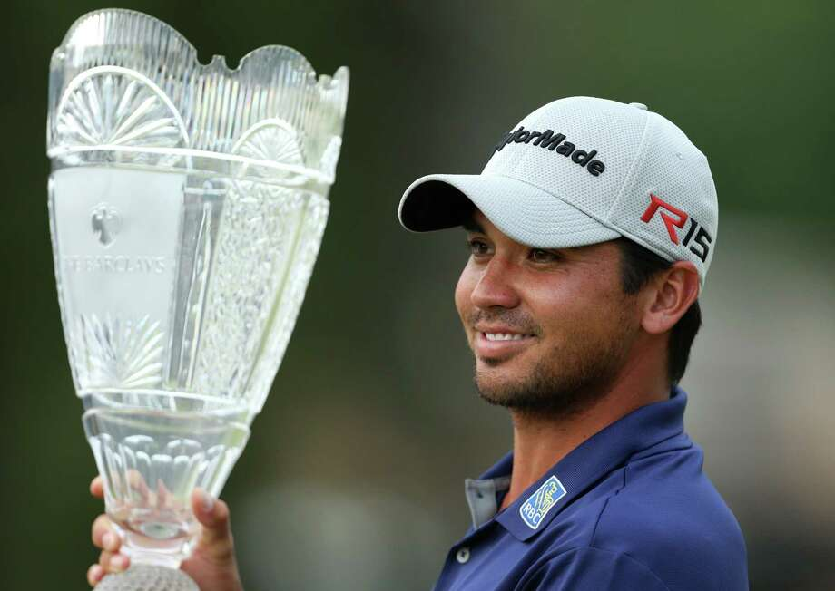 Jason Day holds up the trophy after winning The Barclays on Sunday. Photo: Adam Hunger — The Associated Press   / FR110666 AP
