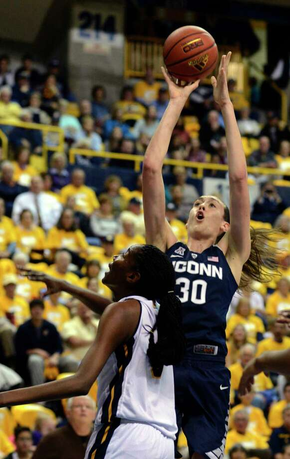 UConn's Breanna Stewart, right, shoots over Chattanooga's Jasmine Joyner in the first half Monday. Photo: Billy Weeks — The Associated Press   / FR67639 AP