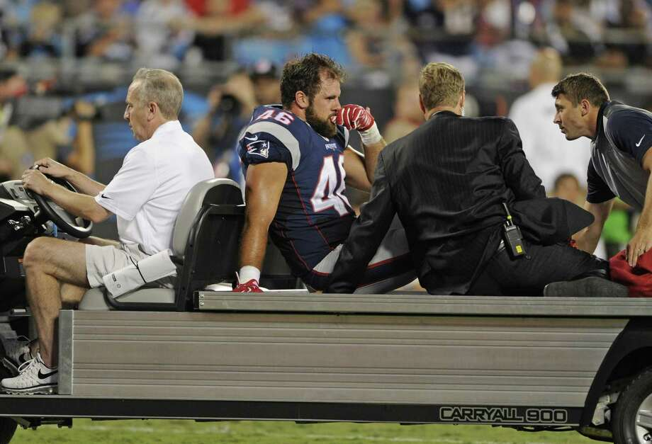 Patriots fullback James Develin (46) is helped off the field on a cart after being injured in Friday's preseason game against the Panthers. Photo: The Associated Press   / FR34342 AP