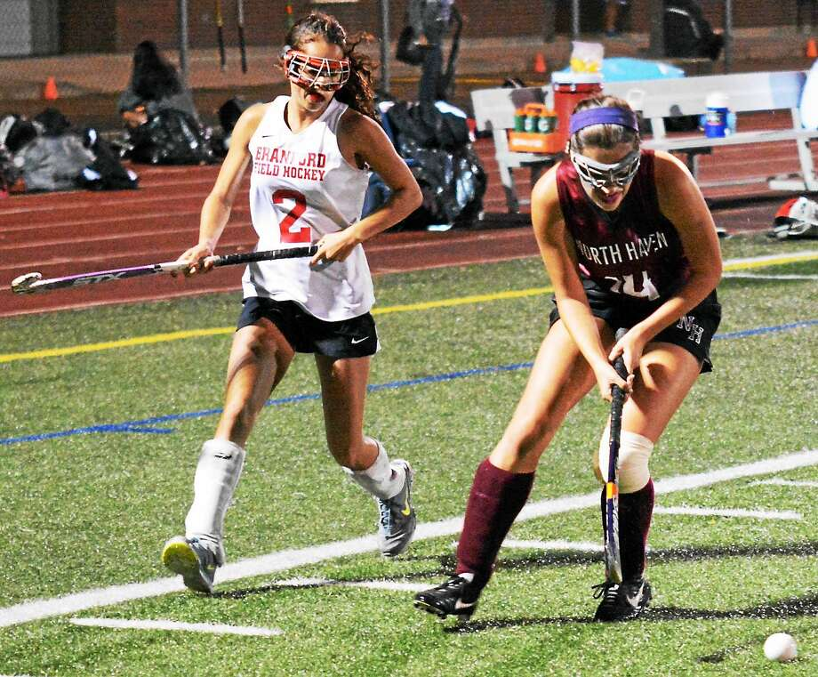 North Haven's Tori Kaponis controls the ball ahead of Branford's Liante Claude during Tuesday's game. Photo: Dave Phillips -- GameTime CT