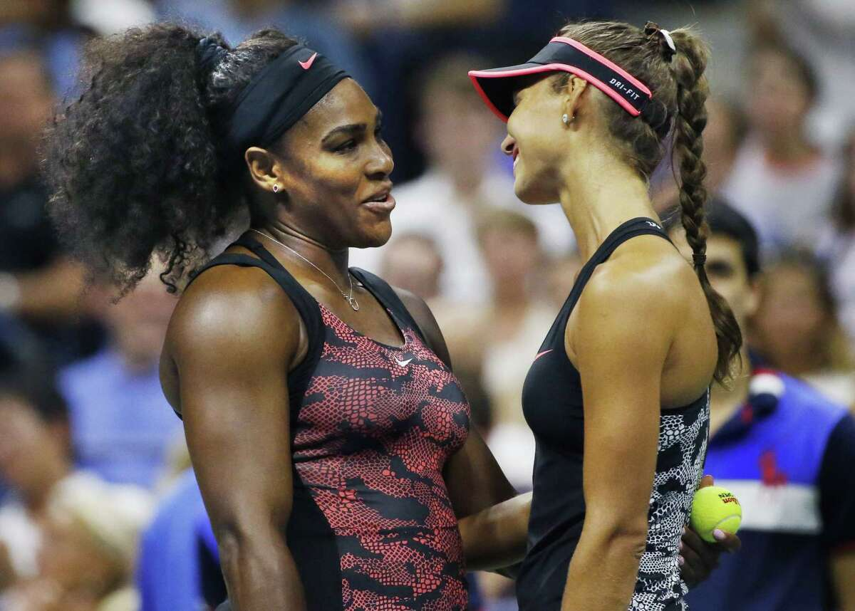 Serena Williams, left, consoles opponent Vitalia Diatchenko after Diatchnko stopped playing because of an injury during their first-round at the U.S. Open on Monday.
