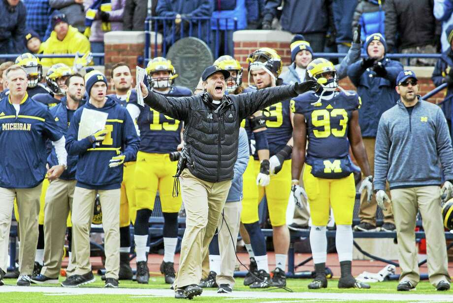 Jim Harbaugh and Michigan will take on Florida in the Citrus Bowl. Photo: Tony Ding — The Associated Press File Photo   / ? ASSOCIATED PRESS