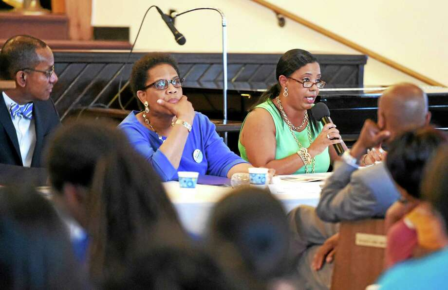 From left, Dr. Gary Rhule, M.D., and Enola G. Aird, president of the Community Healing Network, listen to Dori J. Dumas, president of the Greater New Haven NAACP, during a community conversation Thursday at Bethel A.M.E. Church in New Haven. Photo: (Peter Hvizdak — New Haven Register)   / ©2015 Peter Hvizdak
