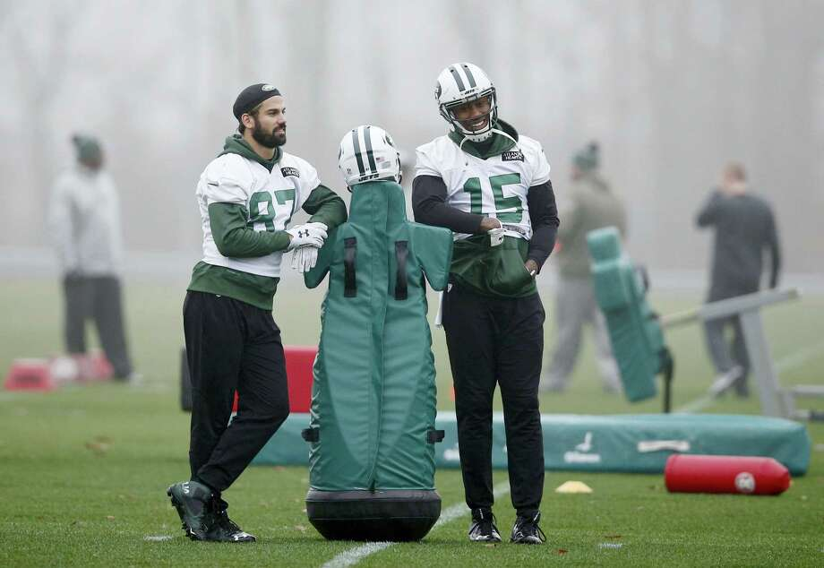 New York Jets wide receivers Eric Decker (87) and Brandon Marshall (15) lean on a blocking dummy before practice Wednesday in Florham Park, N.J. Photo: Kathy Willens — The Associated Press   / AP