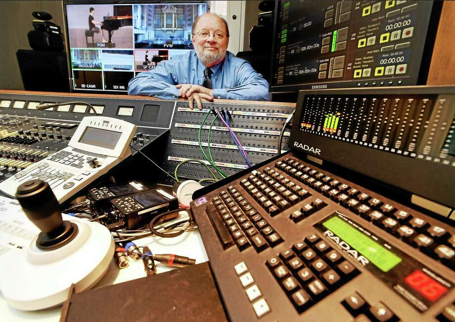 Yale School of Music's  Eugene Kimball, a sound engineer and a member of the faculty as lecturer in sound recording, pauses in the school's Fred Plaut Recording Studio during a simulation of a recital at Morse Recital Hall, left, by Sean Kennard. The studio is synched to remote-controlled cameras at Yale concert venues. Photo: Peter Hvizdak — New Haven Register Photos   / ©2015 Peter Hvizdak
