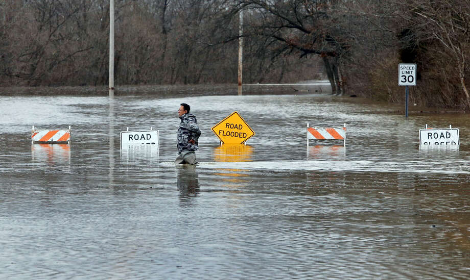 A man crosses Smizer Mill Road in southwest St. Louis County Wednesday. Photo: J.B. Forbes/St. Louis Post-Dispatch Via AP   / St. Louis Post-Dispatch