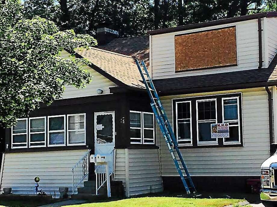 The home at 18 North St. in West Haven. The smell of smoke still lingered around the home and a contractor was on scene boarding up windows late Friday morning. Photo: Wes Duplantier/New Haven Register