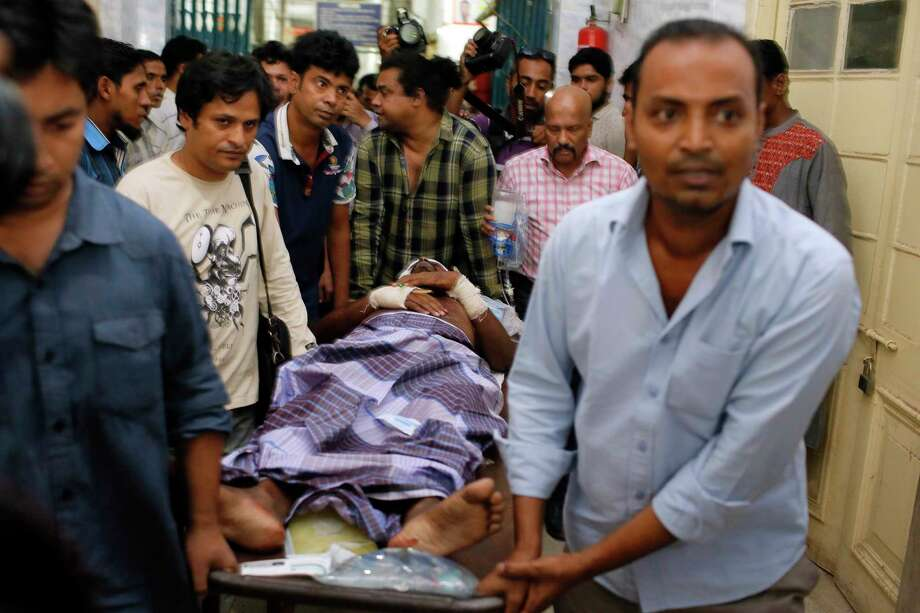 An injured publisher Ahmed Rahim Tutul is carried on a stretcher to the Dhaka Medical College Hospital in Dhaka, Bangladesh, Saturday, Oct. 31, 2015. A publisher of secular books was hacked to death and three other people, including Tutul, were wounded in two separate attacks Saturday at publishing houses in Bangladesh's capital, police said. The attacks in Dhaka come amid fears about the rise of radical Islam in Bangladesh. Photo: AP Photo/A.M. Ahad    / AP