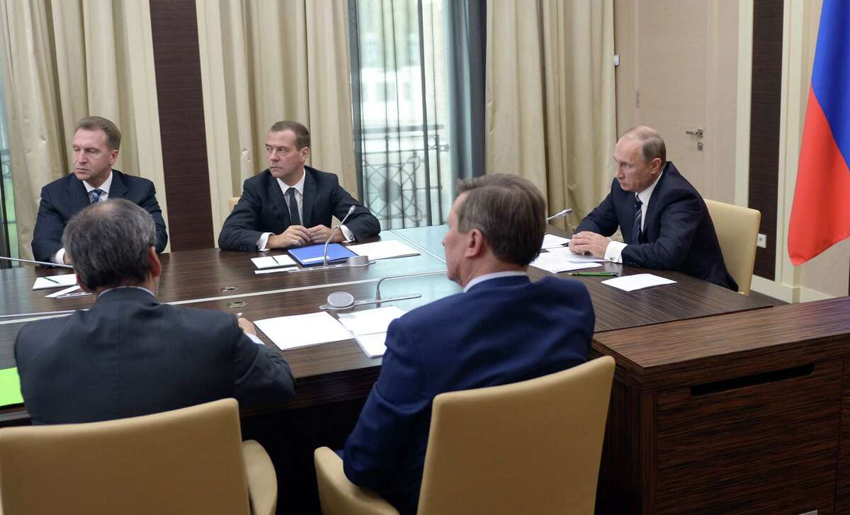 Russian President Vladimir Putin, right, holds a meeting with senior government officials at the Novo-Ogaryovo residence outside Moscow, Russia on Sept. 30, 2015. Russian military jets carried out airstrikes in Syria on Wednesday for the first time, after President Vladimir Putin received parliamentary approval to send Russian troops to Syria. Background from left: Igor Shuvalov, first deputy premier, Dmitry Medvedev, Premier.
