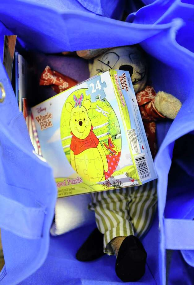 Help For Our Community, a Fitchburg-based organization, dropped off 100 bags with supplies for children placed in emergency foster care at the Leominster DCF office on April 18, 2015. Photo: Christine Hochkeppel/Worcester Telegram & Gazette Via AP   / Worcester Telegram & Gazette