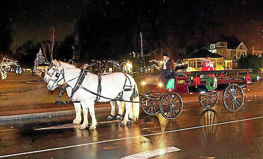 The horse-drawn carriage, seen at a previous Lamplight Stroll, always brings folks back to a simpler time. Photo: Contributed Photo