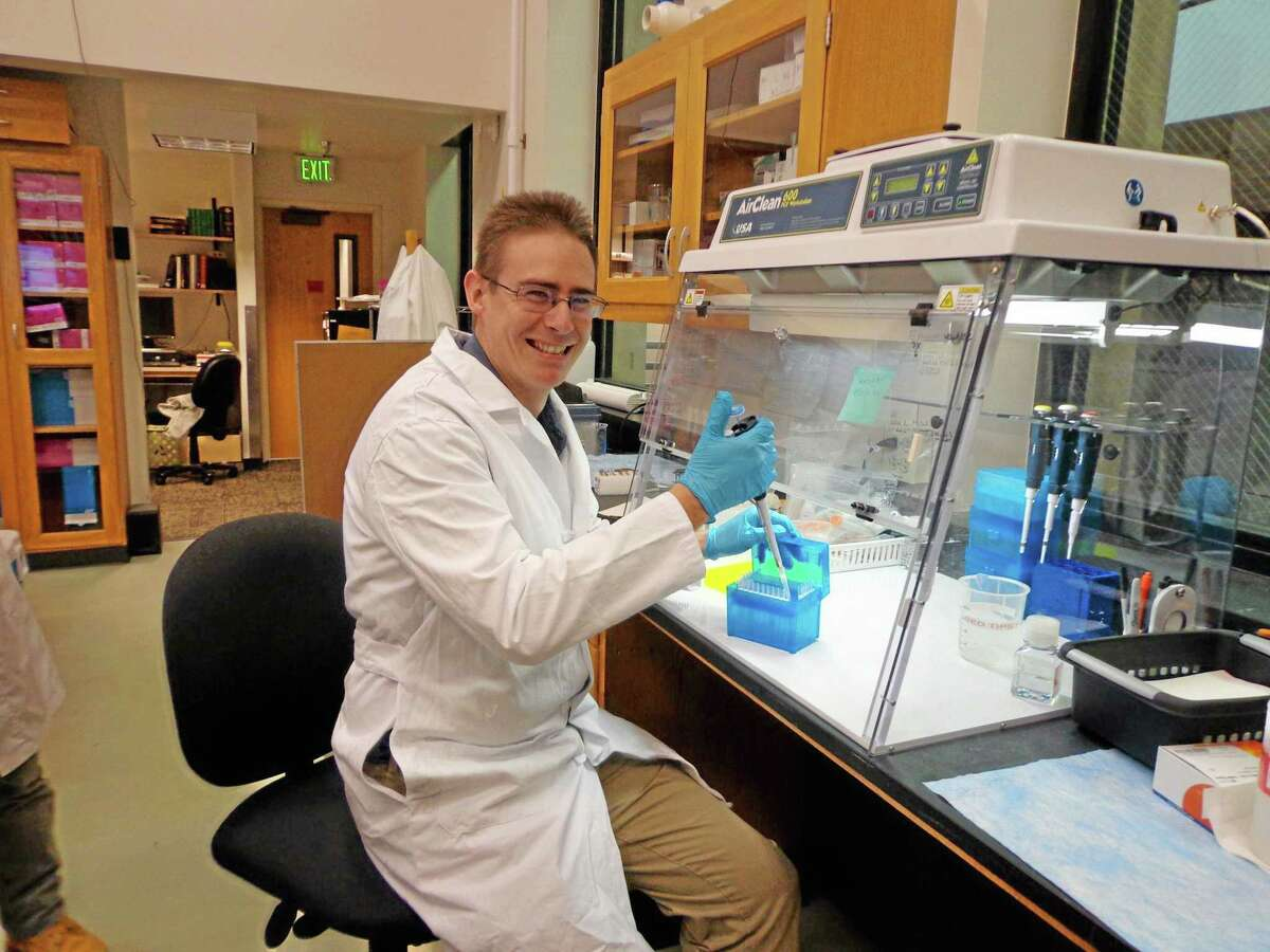 FILE-- This undated photo provided by the University of Colorado shows scientist Rob Knight in his lab at the University of Colorado, Boulder, where he is leading the American Gut Project.