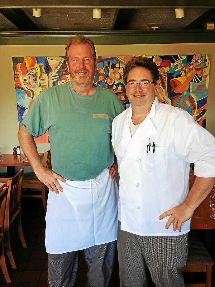 Stone House Restaurant co-owners Jim Quinlivan, left, and Peter Hamme enjoy their last day at the restaurant Friday in Guilford. Photo: Tim Rizzo — New Haven Register