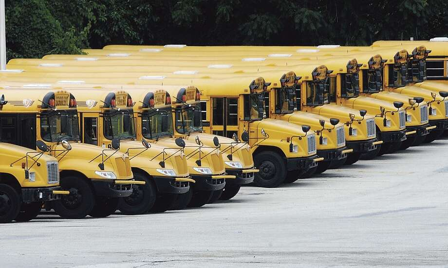 Buses parked in a school district in this 2011 file photo. Photo: DFM File Photo