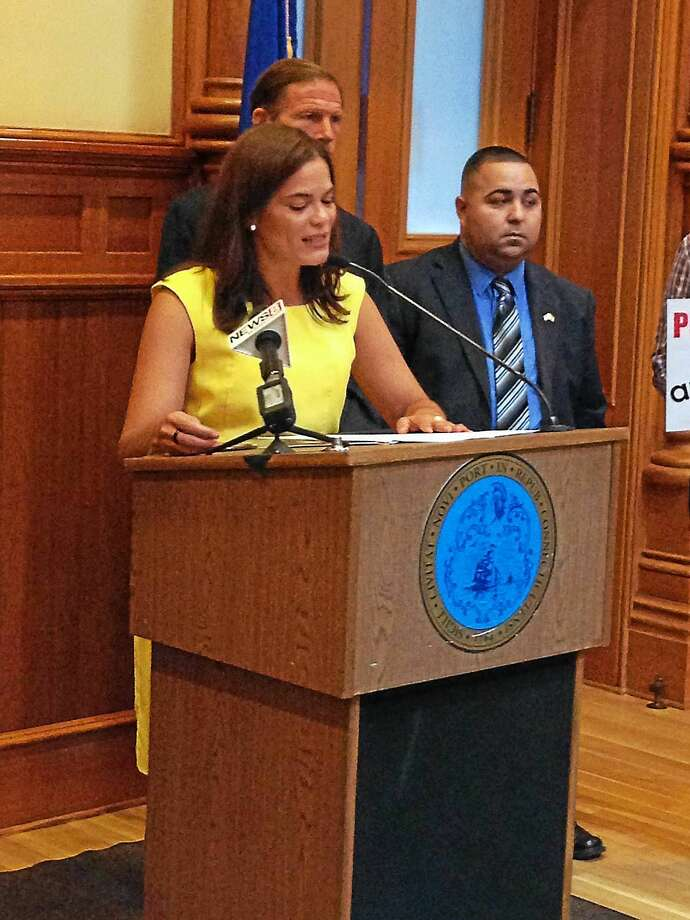 Ingrid Alvarez, the Connecticut State Director of the Hispanic Federation emphasized equality for Puerto Rican citizens in the United States. Photo: Tim Rizzo - New Haven Register