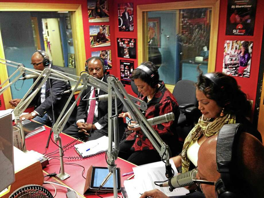 From left, Democratic challengers Ron Smith and Sundiata Keitazulu and Democratic incumbent Mayor Toni Harp get their message across to voters as Angela Carter of the New Haven Register looks on during a mayoral debate at WYBC radio, 94.3 FM., Saturday, Oct. 31, 2015. Photo: Mark Zaretsky — New Haven Register