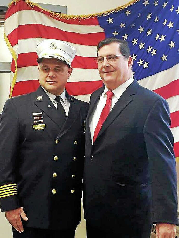 FACEBOOK PHOTO VIA MAYOR ED O'BRIEN  New West Shore Fire Chief Stephen Scafariello with West Haven Mayor Ed O'Brien immediately after taking the oath of office on Saturday. Photo: Journal Register Co.