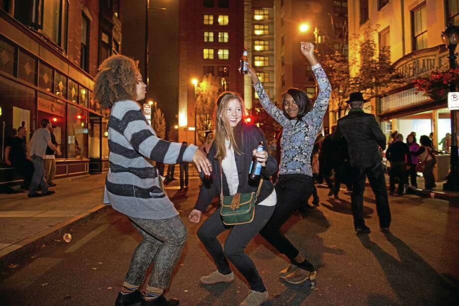 Friends dance in Ninth Square on opening night last year. Photo: Artspace   / Copyright Graham Hebel 2014. All Rights Reserved.