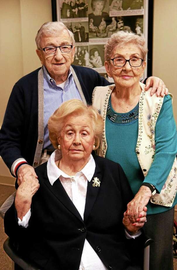 Shifra Zamkov, sitting, with Isidor Juda, left, and Helene Rosenberg, all of New Haven and all Holocaust survivors. Photo: Peter Hvizdak — New Haven Register   / ?2015 Peter Hvizdak