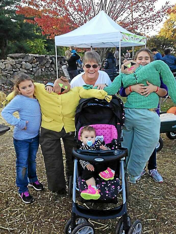 Family members enjoy last year's scarecrow-making event. Photo: Contributed